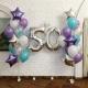 Композиция из бирюзово-сиреневых шаров со звездами и цифрой 50