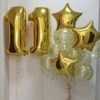 Фонтан из прозрачных шаров с конфетти со звездами и цифрой 11