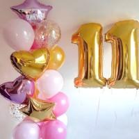 Фонтан из розово-золотых шаров со звездами и цифрой 11