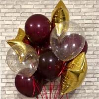 Фонтан из бордовых и прозрачных шаров с золотыми звездами