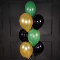 Фонтан из черных, золотых и зеленых шаров