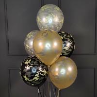 Фонтан из черных, золотых и серебряных камуфляжных шаров
